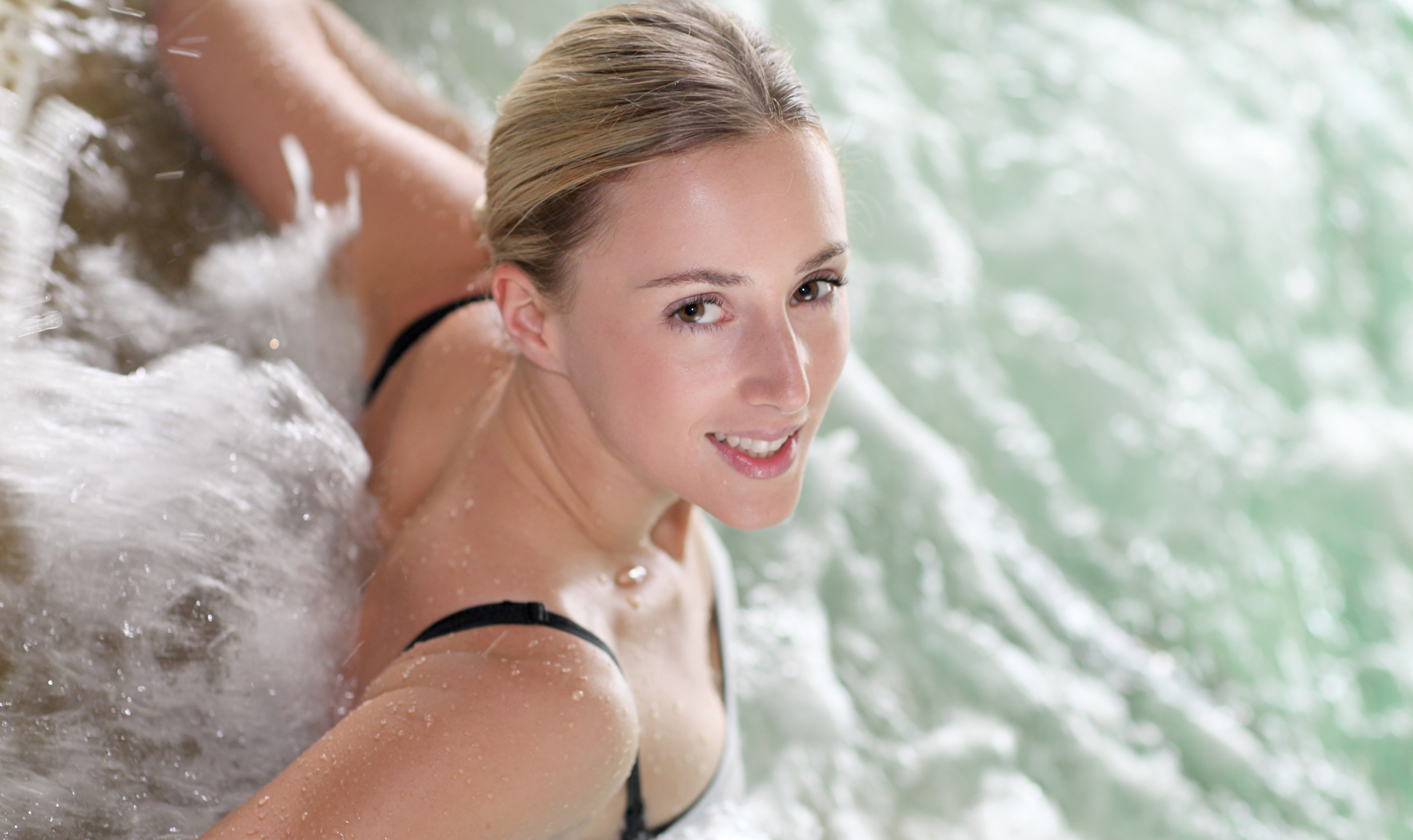 Smiling woman in a hot tub